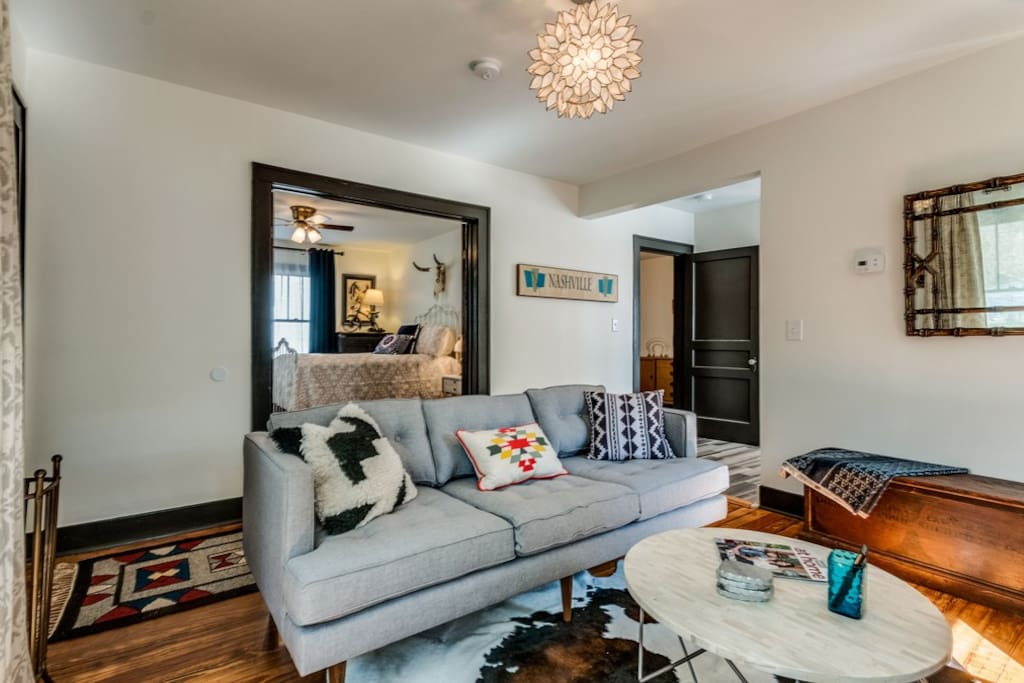 ~West Elm meets Urban Cowboy with vintage furnishings from all over the country, yet modern elements for your comfort like this West Elm sofa~