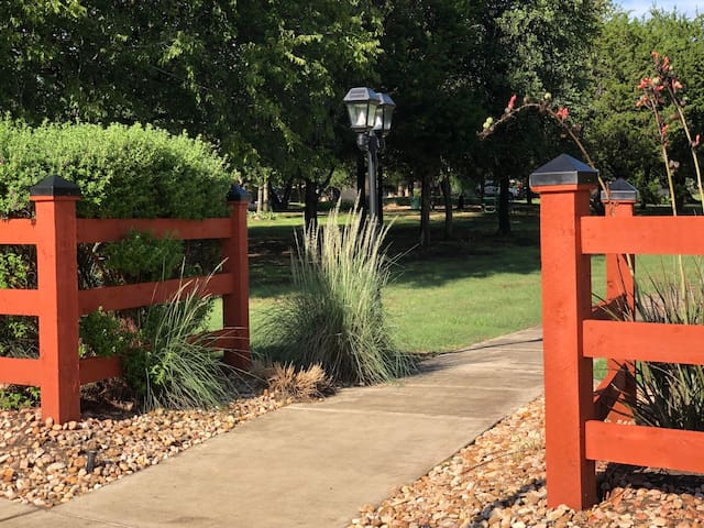 Take a leisurely evening walk or morning run on the trail behind our home