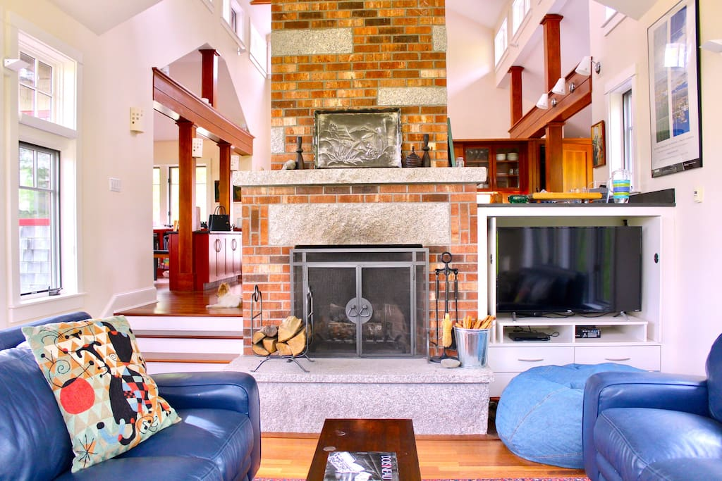 """Sunken living room with fireplace, two sofas and 48"""" streaming TV. The fireplace is stocked and ready year round.  All photos by Chip Cordelli, @chipper1969."""