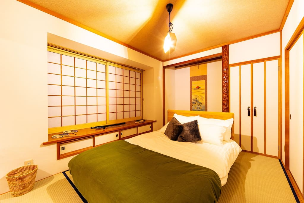 This is the SAMURAI styled bedroom. Decorated with Japanese sword (katana), hanging scroll, folding fan, all of which represent the Japanese traditions and cultures. This room is pouring with a Japanese ambience.