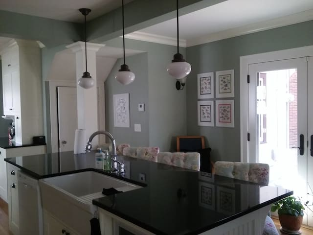 Gourmet / entertainer's dream kitchen seats 4. Cable TV and french doors to patio.