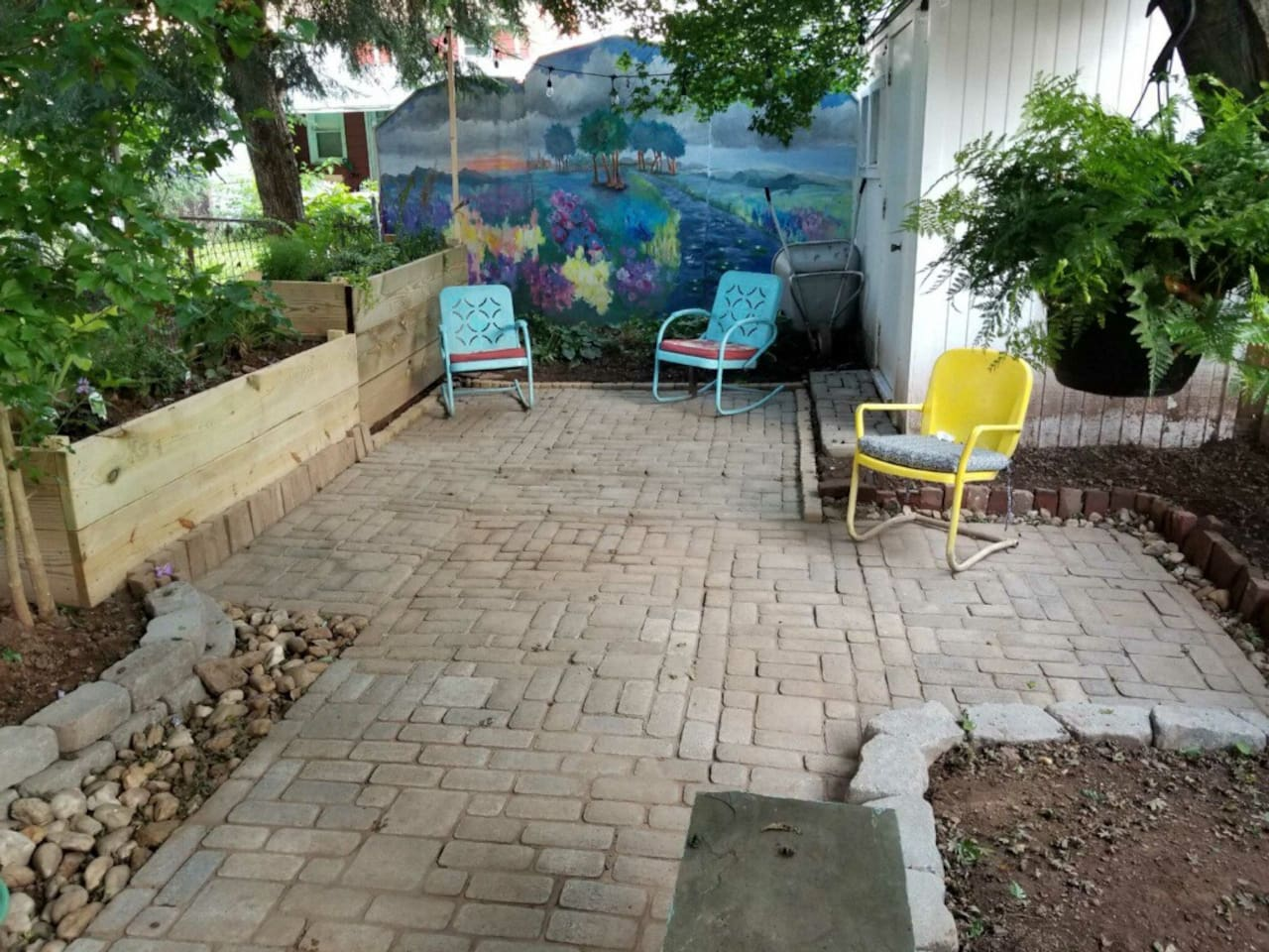 Sit and enjoy the great outdoors and a wall mural from a Phoenixville resident