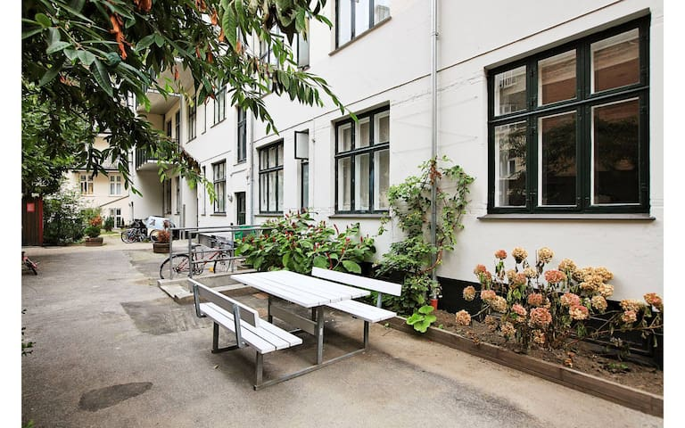 Courtyard outside kitchen - with benches and playground