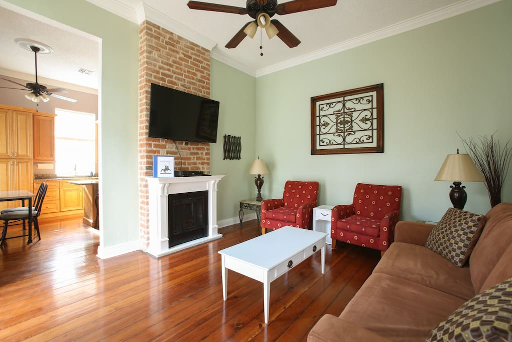 """Living room features 55"""" cable HDTV, sleeper sofa, electric fireplace, etc."""