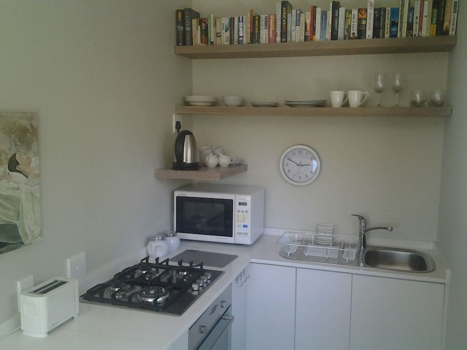 Fully equipped kitchen with fridge/freezer, toaster, microwave, kettle, gasstove and electrical oven.  Tableware and cutlery: 4 of everything.