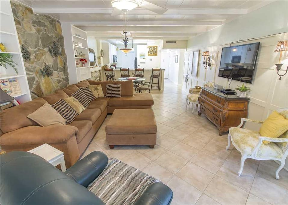 Spacious Living Room - Large comfortable couches, cable HDTV, and ceiling fan so you can enjoy your evenings with family and lots