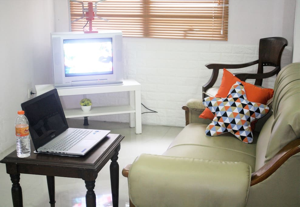 you can use the side table and turn it into your comfortable working spot while watching tv