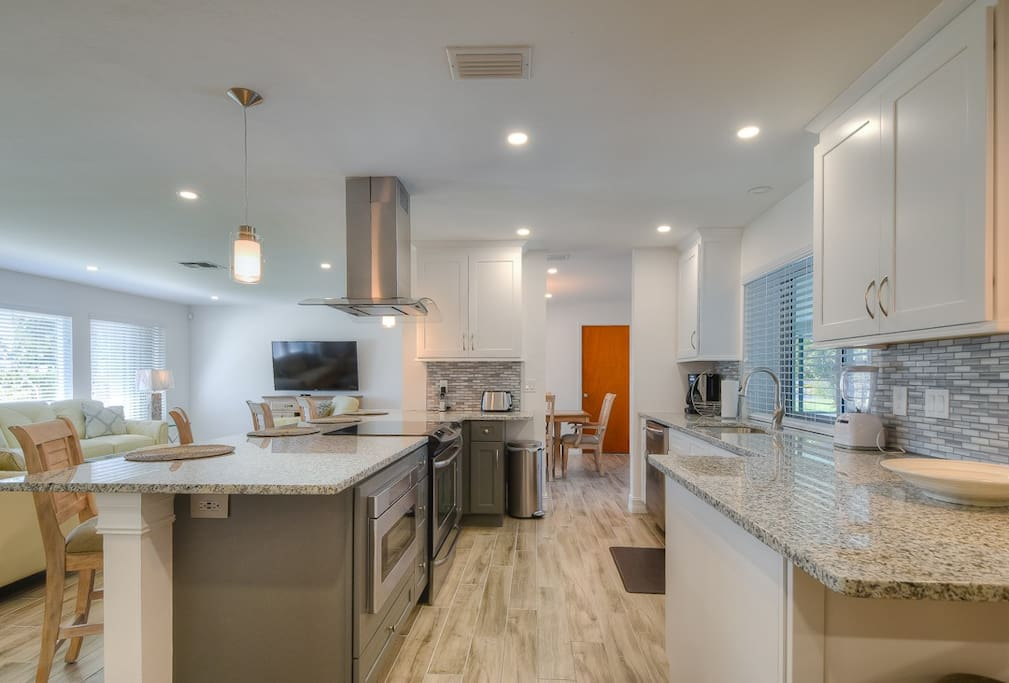 The kitchen features granite counters and stainless steel appliances