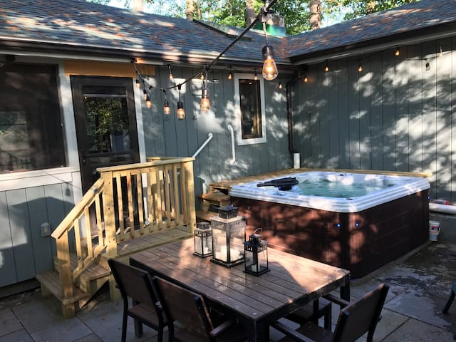 Outdoor patio with hot tub spa