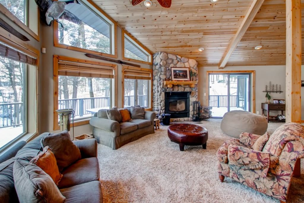 The rustic interior features stained glass windows and wildlife mounts.