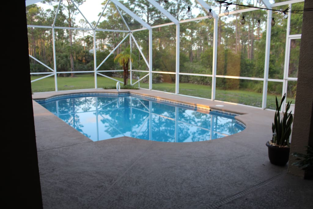 Relax by the pool and covered patio.