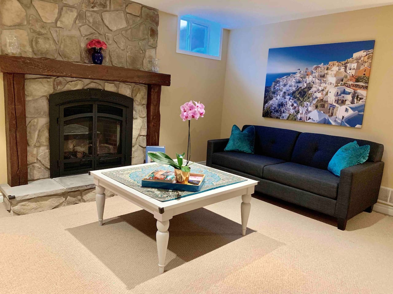 Enjoy this beautiful, Airy living room with the gas fireplace