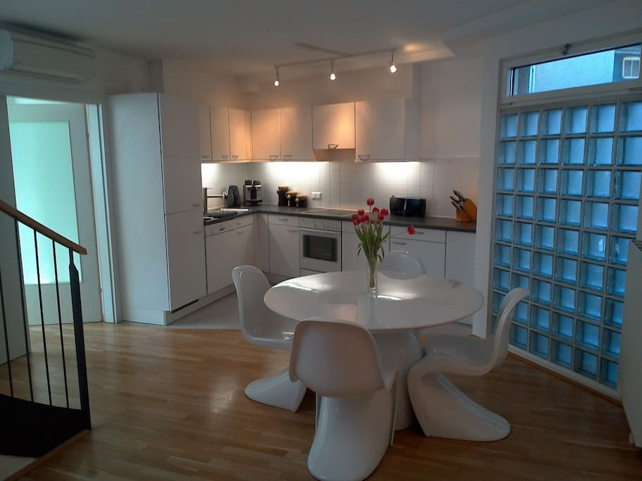 Modern dining and kitchen area, the stairs to the left lead to the private rooftop terrace