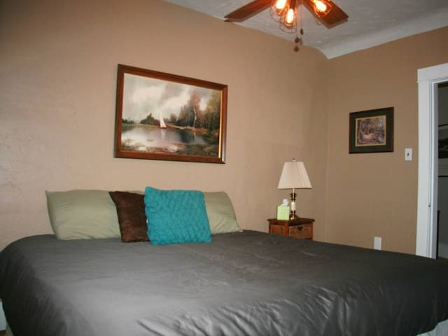 This bedroom is setup as a king and has a view of the lake similar to the photo shown here.  This king can be split into two XL twin beds if needed. Wood floors