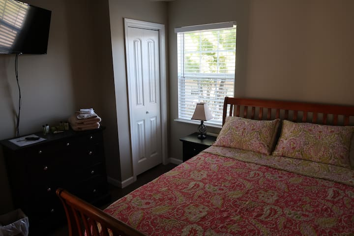 2B Private Queen bedroom in a shared space.