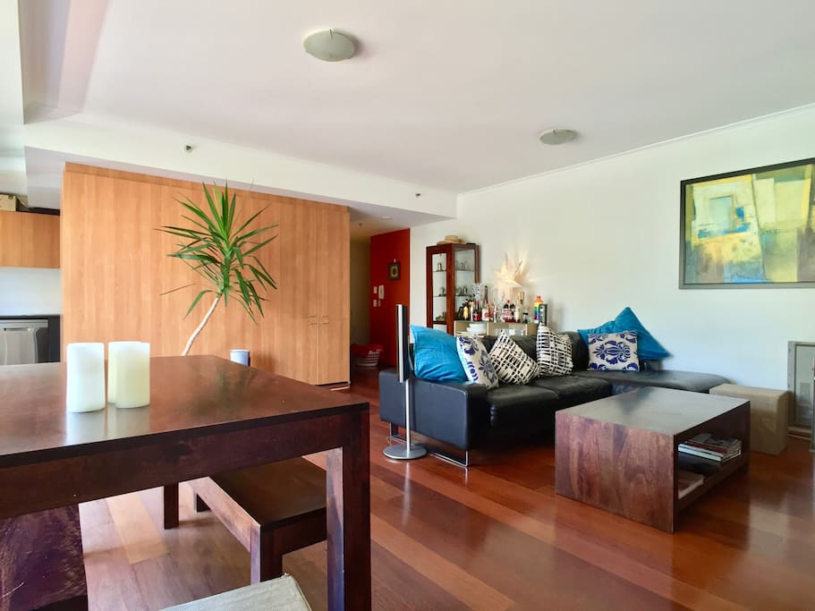 Combined living and dining area with polished wooden floors