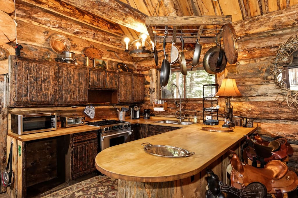 Saddle up to the bar in the kitchen of the main house.  The kitchen is fully equipped with everything you need!