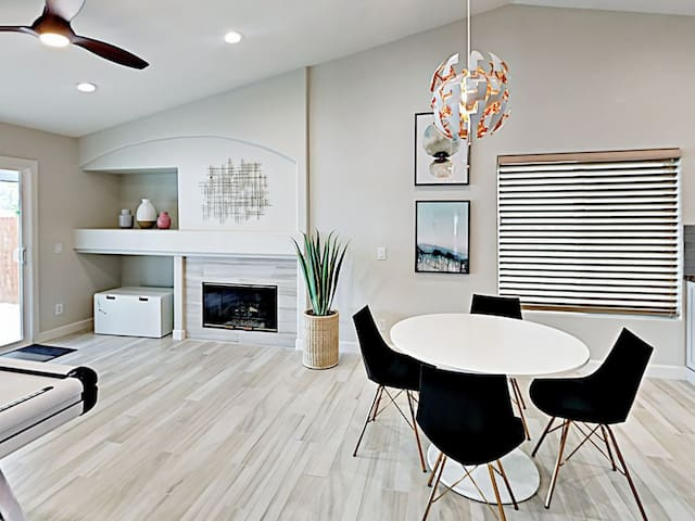 Sip Nespresso morning coffee beside the gas fireplace at a 4-person table in the living room