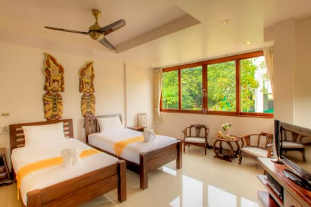 Spacious room with two single beds