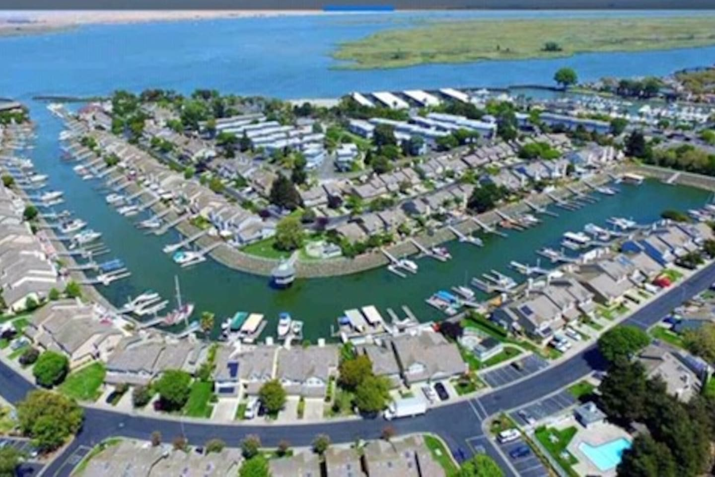 An aerial view from South looking North of my community and confluence of Sacramento & San Joaquin rivers. Browns Island in the background. Very popular water sports and fishing spots. The Pittsburg Yacht club 100 yards from my door step.