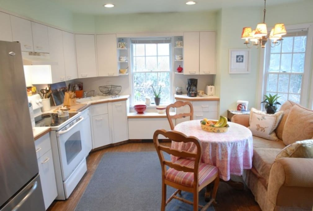 Kitchen with cute breakfast nook and everything you need to cook and serve