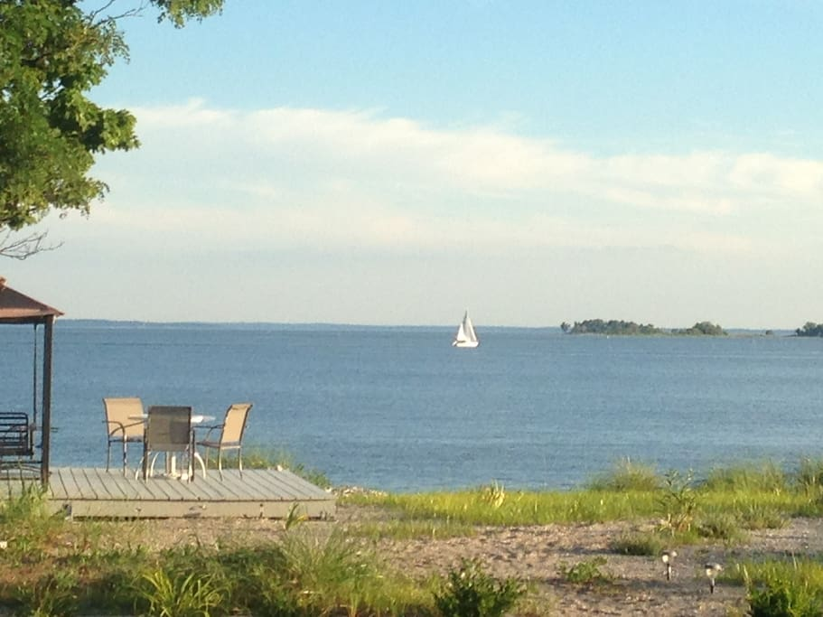 Your own private beach! Beach deck, tranquil & shady glider swing and table for up to 6 (new table). You can have bonfires or launch a sailboat/kayak/rowboat from your OWN beach.