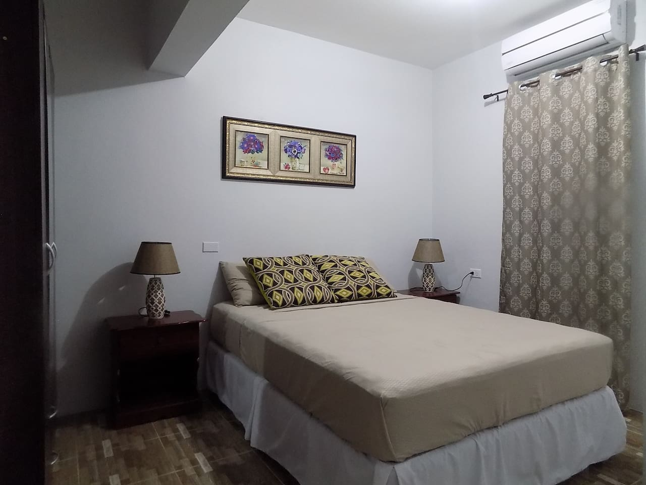 Spacious room with queen size pillowtop bed and ac just for your comfort.