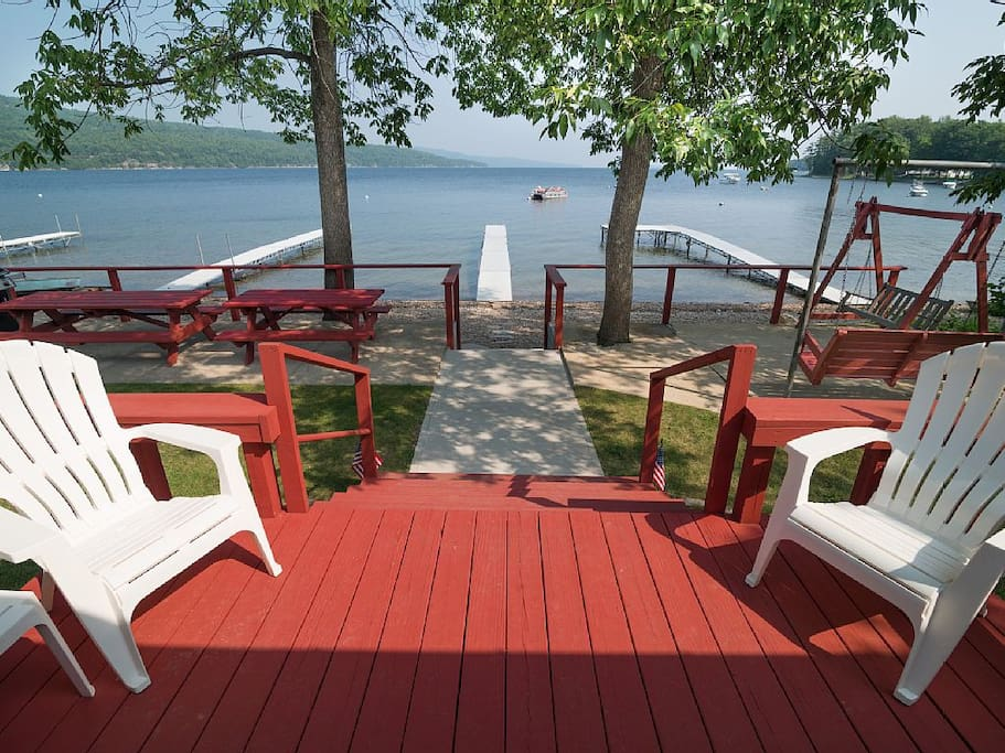 A deck, 2 patios, 2 swings, dock, boat mooring, grill.