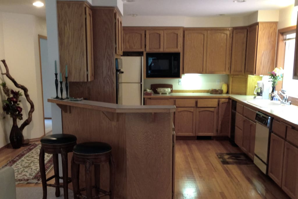 Kitchen is fully equipped with dishes & cookware.