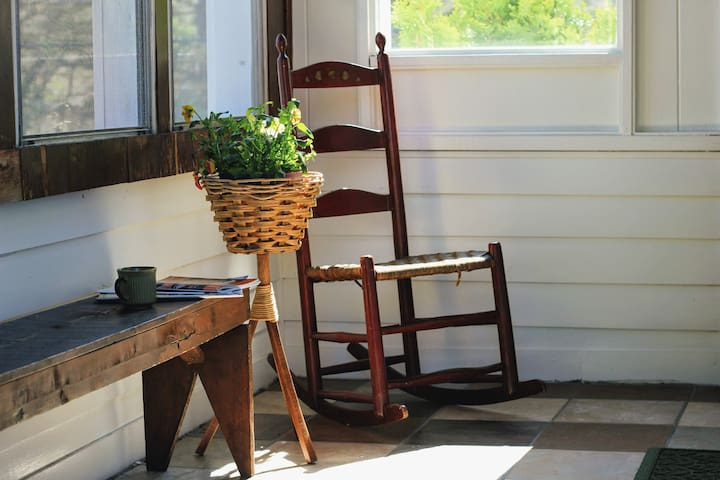 Enter the cottage through the sunny side porch.