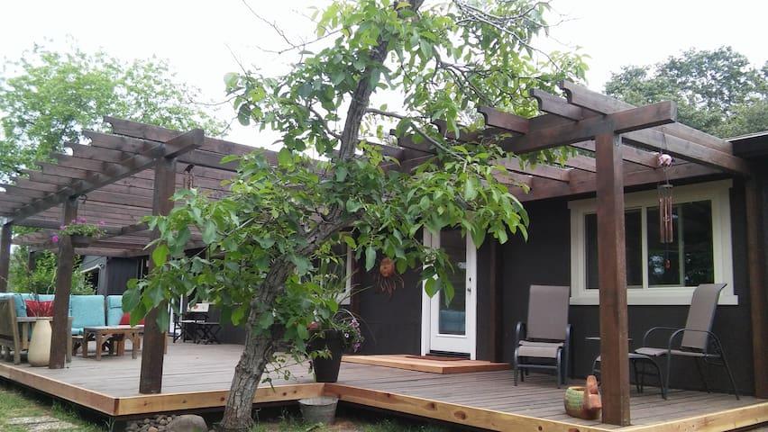Front door and spacious deck