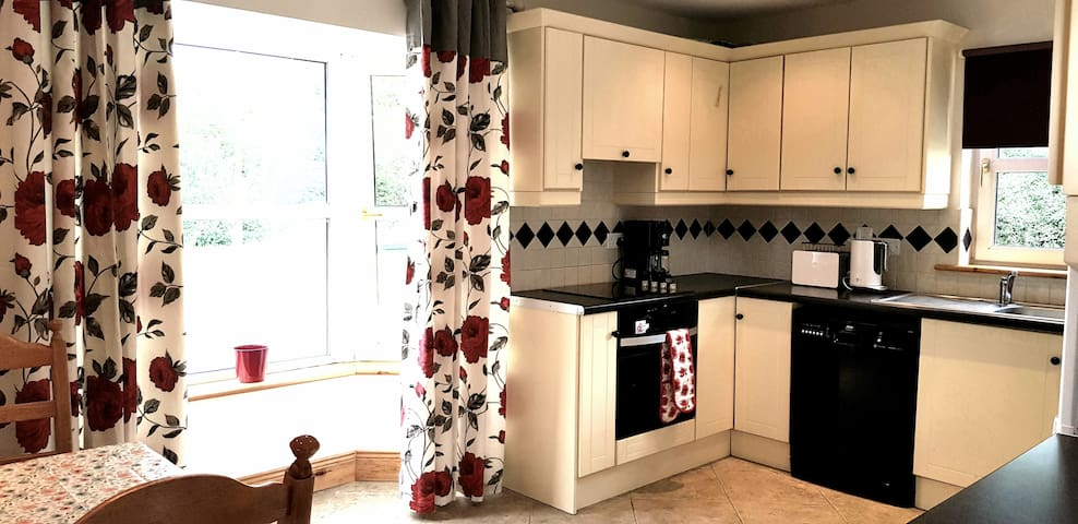 Kitchen/Dining room  We provide a microwave,  a coffee maker, a toaster, a kettle, a washing machine and a dishwasher for your convenience. Full oven and 4 ring ceramic hob, fridge/freezer.