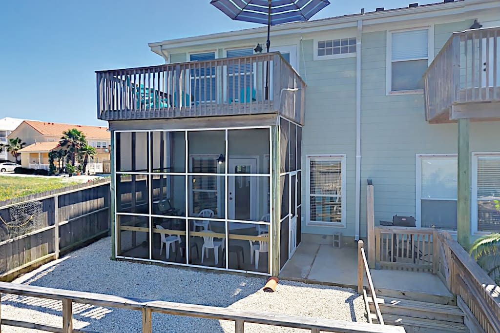 Enjoy two levels of outdoor living, including a screened-in porch and sunbathing deck.