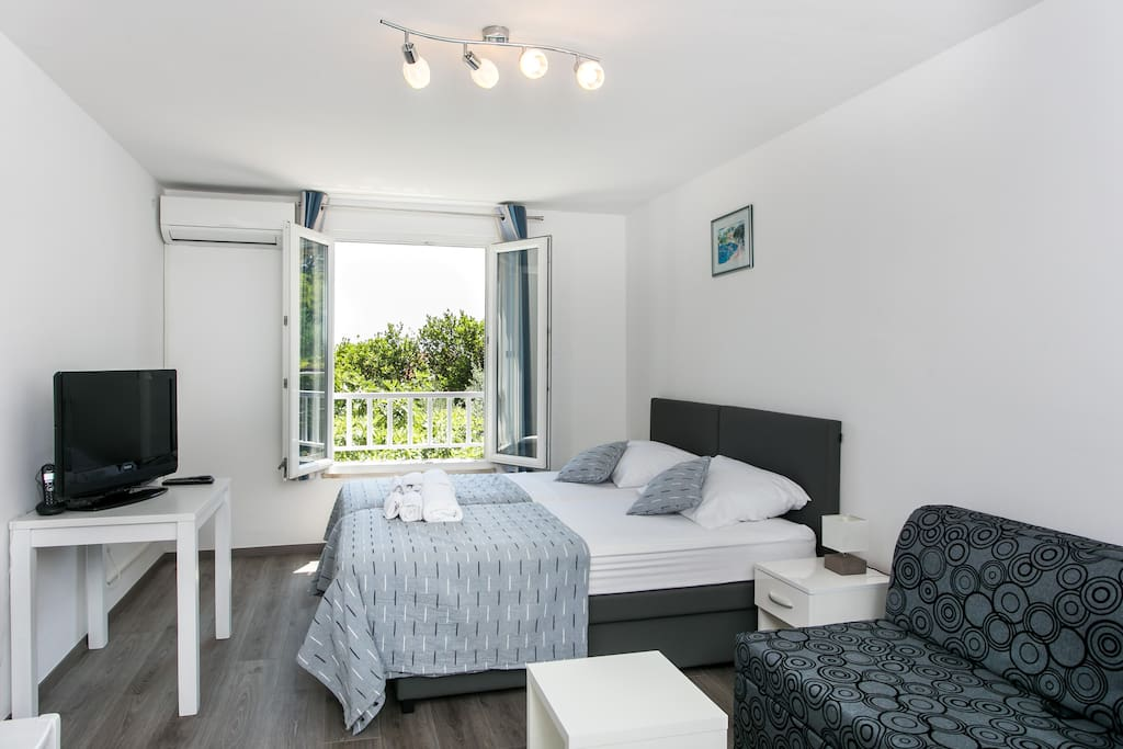 Modern decorated bright bedroom with lovely view