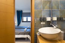 bathroom that connects the two bedrooms