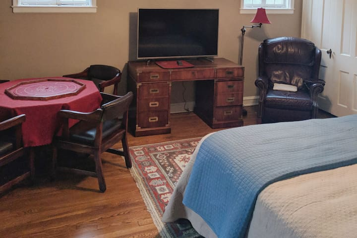 Game table, recliner and a 55 inch TV in your airy large room.