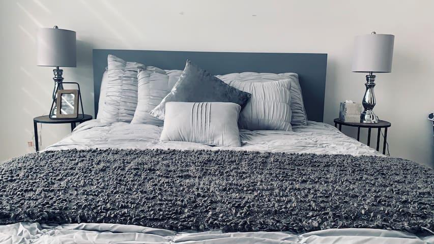 En-Suite Master Bedroom In a Modern Townhome