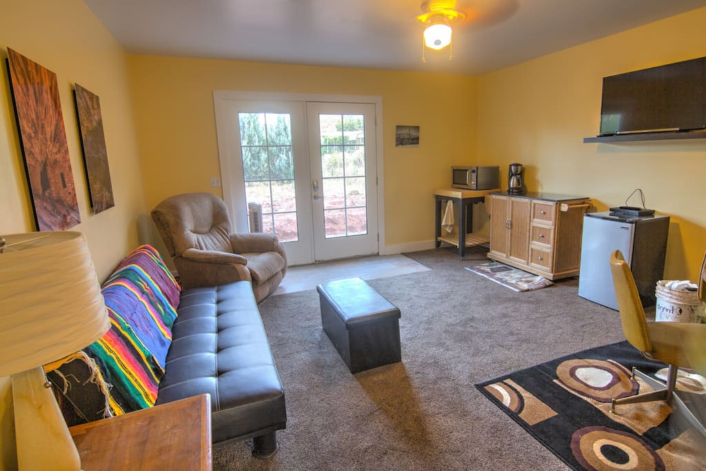 """Living Room. The couch coverts to a bed. The room has a 40"""" flat screen TV, Bluray/DVD player with Netflix, Amazon Hulu and most other streaming services. The suite also has a bluetooth speaker so bring your favorite music."""