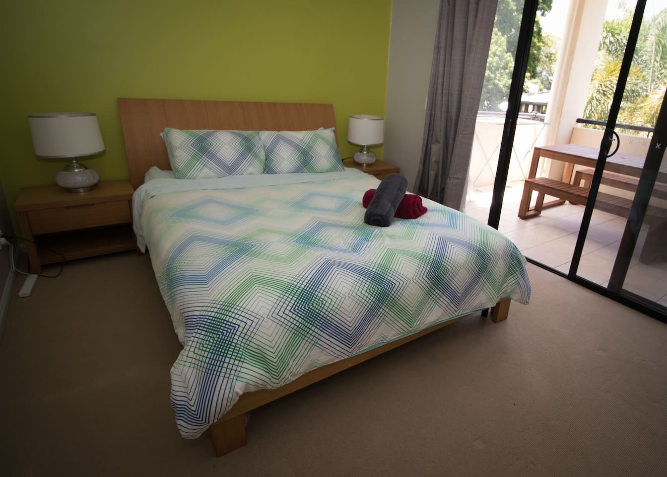 Spacious bedroom with queen bed. Direct balcony access with views of the neighbouring gardens.