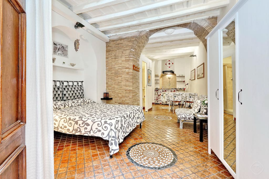 The apartment itself has a large comfortable double bed, a single sofa-bed, cupboards and a flat screen TV for your entertainment. However the real beauty of the apartment is the cosy and warm décor. The apartment is very traditional  with exposed wooden beams on the ceiling, delightful artwork everywhere, a mosaic tiled floor and exposed brick walls.