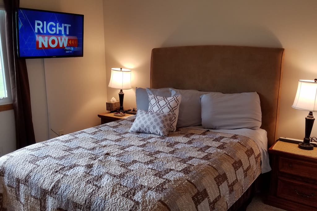 "Select comfort queen bed, 40"" TV w/DirectTV, ceiling fan, 2 end tables each with a power strip."