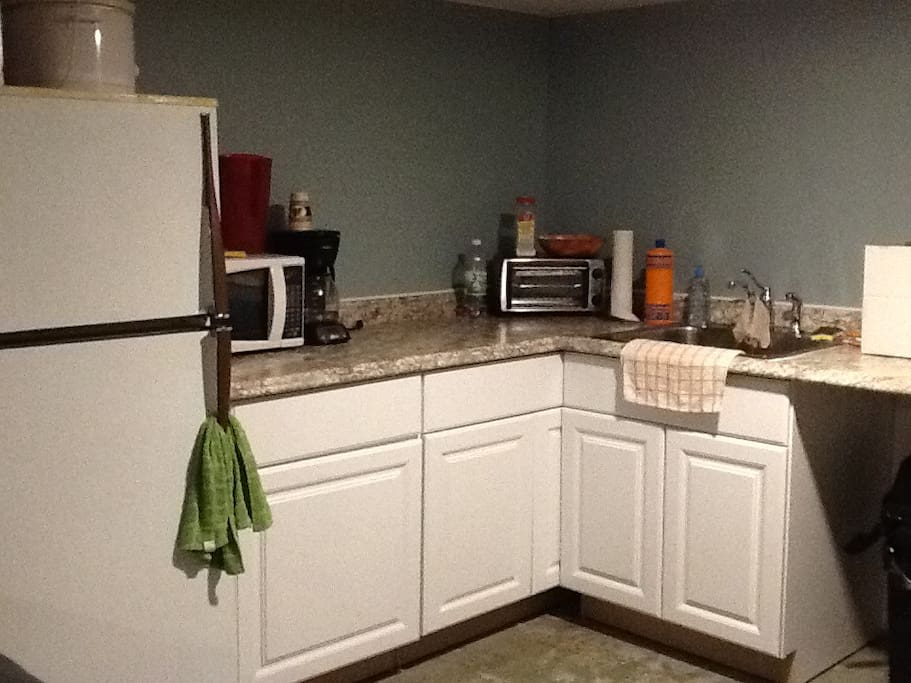 Full size refrigerator, microwave, coffee pot and toaster oven