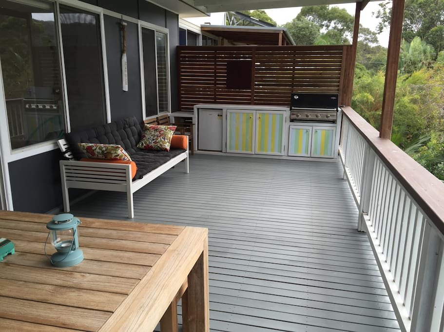 Where we spend a lot of our time - the back deck! Complete with gas BBQ, bar fridge, day bed, dart board and outdoor dining table.