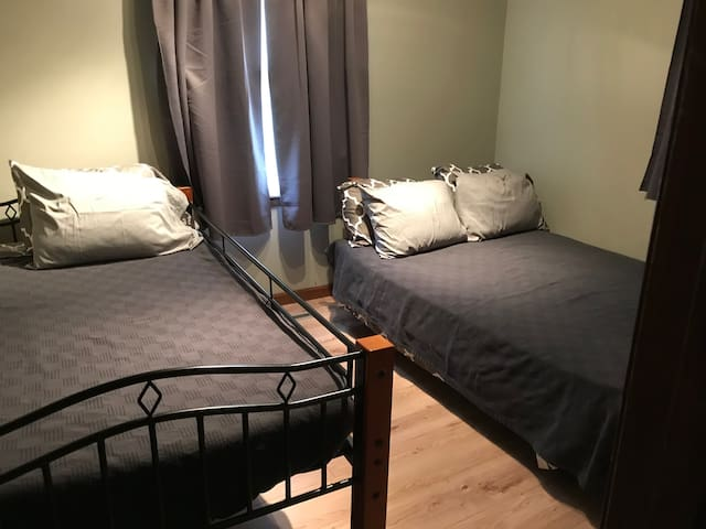 Full size and twin bed in smaller bedroom