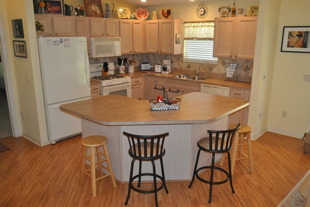 Fully Stocked kitchen ready for your use. microwave, gas stove, refrigerator and dishwasher