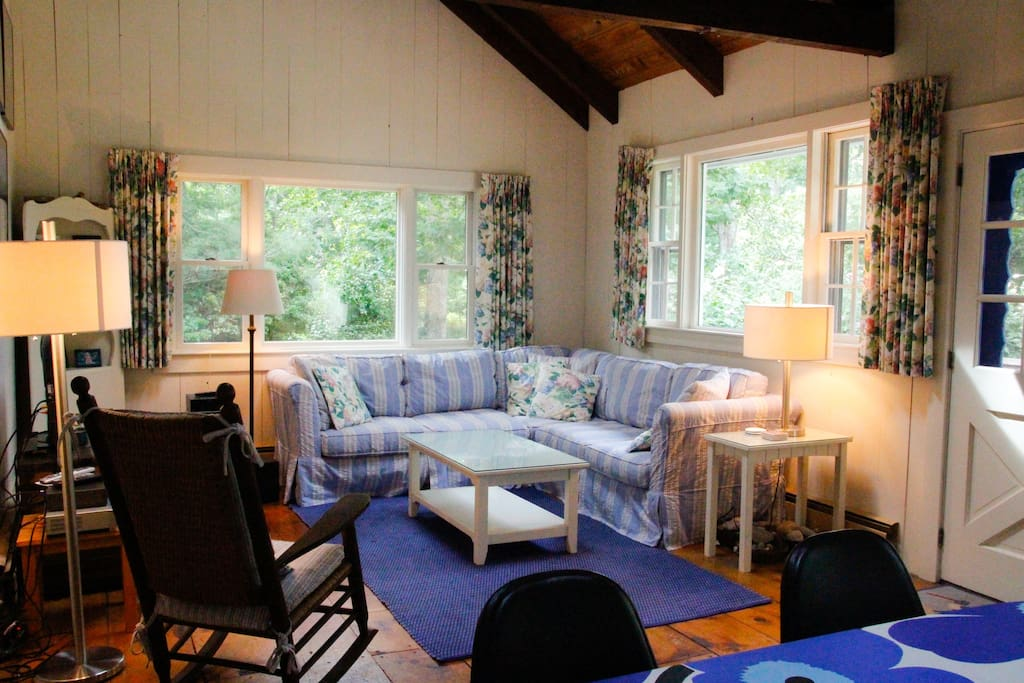 The living room is to the right as you enter the house. It has comfortable sofas, a cushioned rocking chair, and a cable-equipped TV with DVD and VCR. The front of the house faces away from the street, so the living room, which overlooks the yard through two large windows, is bright, quiet, and cozy