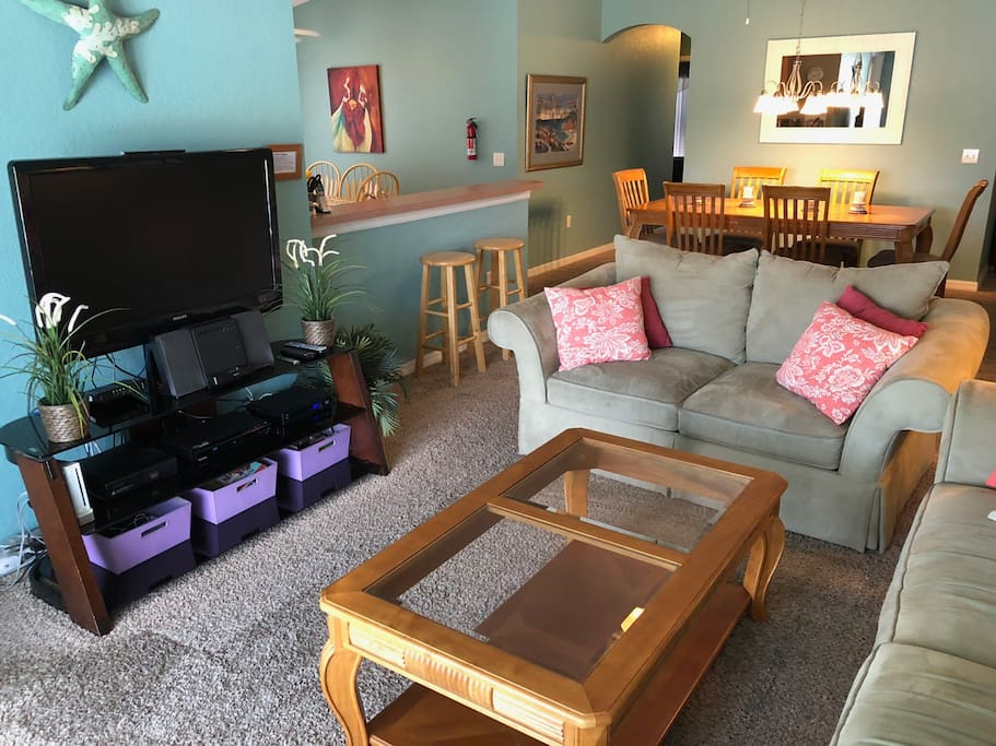 Open concept living/dining/kitchen.  Lots of space to hang out with friends and family.  Opens to pool lanai.