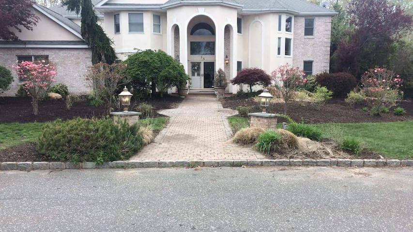One bedroom located in McMansion in East Setauket