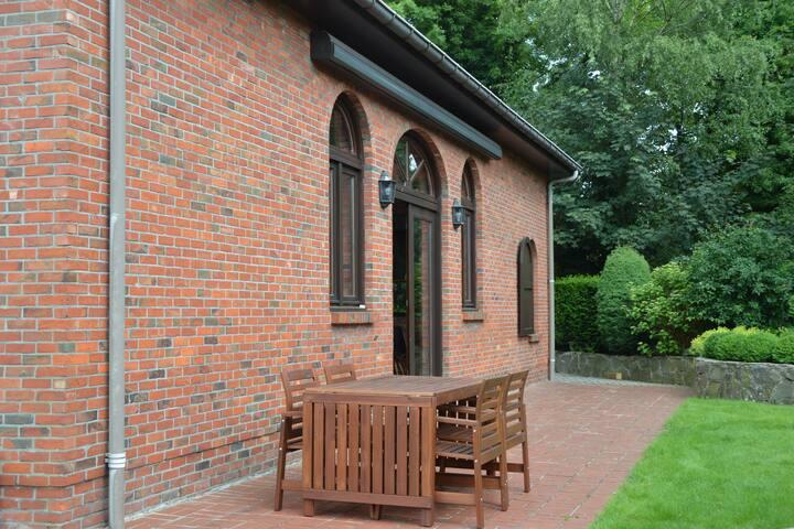 Bel alloggio autentico nel centro di Merksplas con ampio giardino.