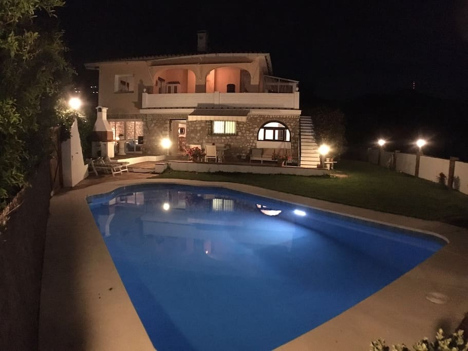 Villa Casa Ladera at night with lighted pool and garden
